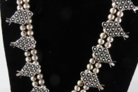 Squash Blossom Necklace set with earrings by Zuni (view 1)